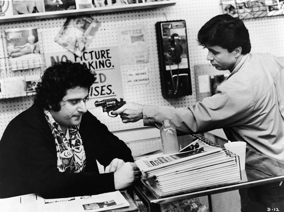 """Or was the classic '70s cop show """"Baretta?"""" This one starred Robert Blake (R), as an undercover cop who liked disguises and his pet cockatoo. The show ran from 1975 to 1978. Blake, acquitted in the murder of his wife in 2005, is pictured in a scene from the show. Photo: United Artists, / / 2003 Getty Images"""