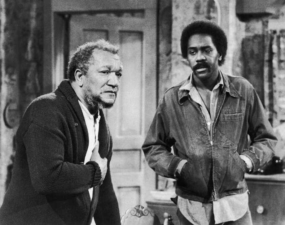 "Redd Foxx (L) and Demond Wilson starred in ""Sanford and Son,"" about a grouchy widow and grown son  who affectionately called each other ""old fool"" and ""big dummy.""  Photo: NBC Television, / / Hulton Archive"