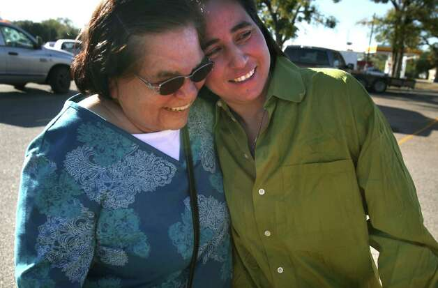 Anna Vasquez (right) embraces her mother Maria Vasquez after she was released from prison on Nov. 2, 2012. Anna, one of four San Antonio women fighting to clear their names in the 1994 sexual assault of two sisters, was released from prison on parole from the Crain Unit in Gatesville. Photo: Bob Owen, San Antonio Express-News / © 2012 San Antonio Express-News
