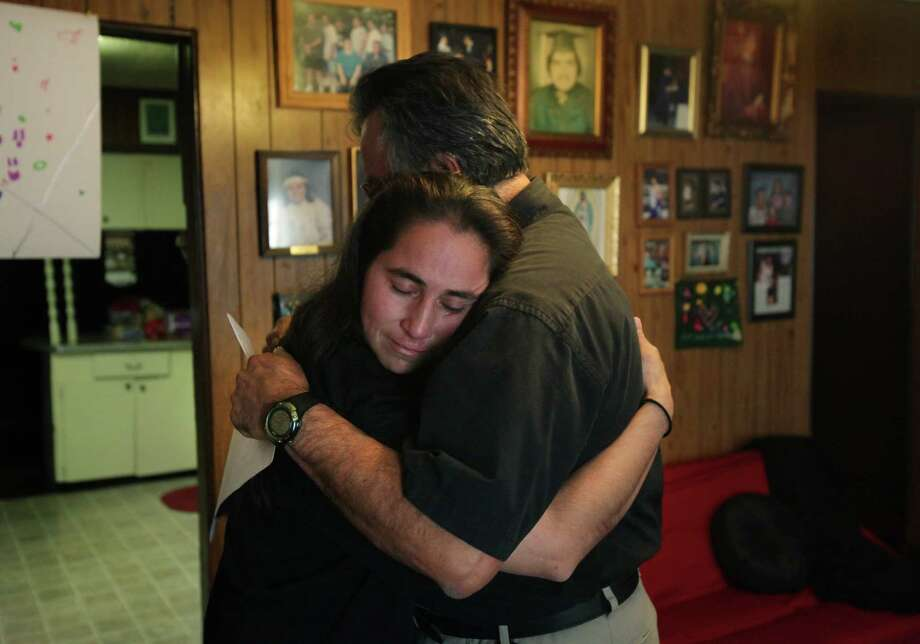 Anna Vasquez (left) appears safe in her brother, Robert Vasquez's arms as she returned home after serving 12 and a half years in prison. Anna, one of four San Antonio women fighting to clear their names in the 1994 sexual assault of two sisters, was released from prison, on parole, from the Crain Unit in Gatesville on Nov. 2, 2012. Photo: Bob Owen, San Antonio Express-News / © 2012 San Antonio Express-News