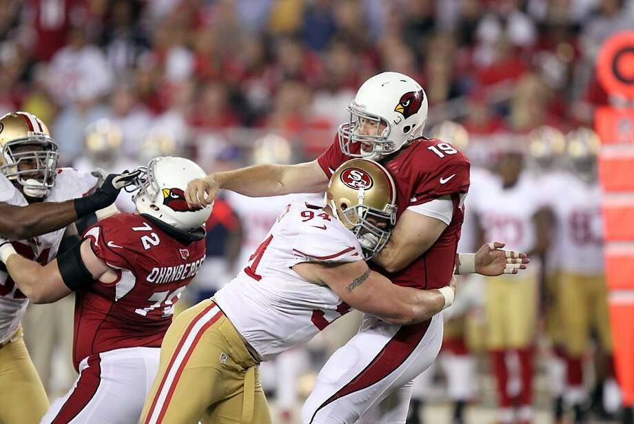 San Francisco 49ers' Justin Smith, left, tackles Arizona Cardinals' John Skelton, right,  in an NFL football game Monday, Oct. 29, 2012, in Glendale, Ariz.(AP Photo/Paul Connors) Photo: Paul Connors, Associated Press