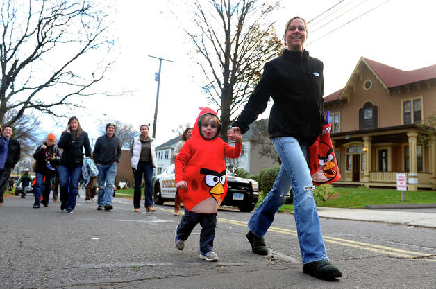 Max Eastman, 4, is dressed up an an Angry Bird as he walks in the parade with his mom Tricia, during the Fourth Annual Black Rock Halloween Parade and Block Party which started at Ellsworth Field and ended at the Black Rock Branch Library for snacks in the Black Rock section of Bridgeport, Conn. on Friday November 2, 2012. The event was organized by the library and the Black Rock chapter of the Rotary Club. Photo: Christian Abraham / Connecticut Post