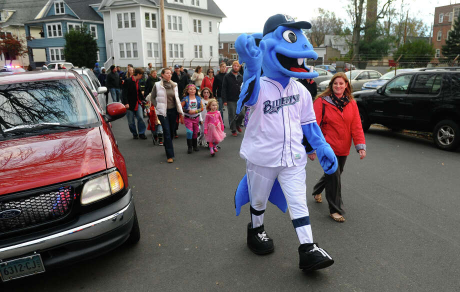 B.B. the Bluefish mascot walks with the kids during the Fourth Annual Black Rock Halloween Parade and Block Party which started at Ellsworth Field and ended at the Black Rock Branch Library for snacks in the Black Rock section of Bridgeport, Conn. on Friday November 2, 2012. The event was organized by the library and the Black Rock chapter of the Rotary Club. Photo: Christian Abraham / Connecticut Post