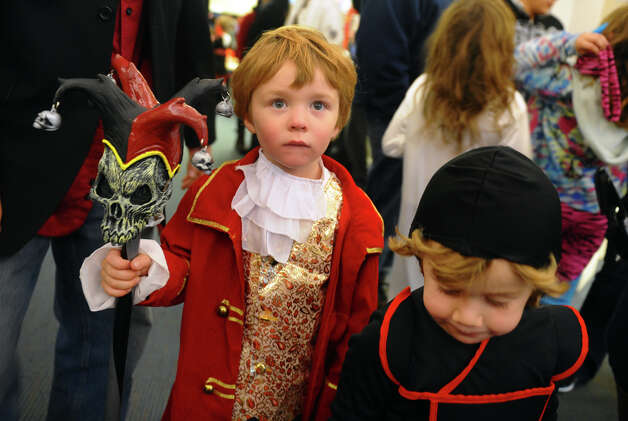 Erik Kiernan, 4, left, plays a pirate and his buddy Sam Castro plays a ninja, during the Fourth Annual Black Rock Halloween Parade and Block Party which started at Ellsworth Field and ended at the Black Rock Branch Library for snacks in the Black Rock section of Bridgeport, Conn. on Friday November 2, 2012. The event was organized by the library and the Black Rock chapter of the Rotary Club. Photo: Christian Abraham / Connecticut Post