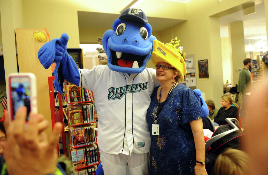 B.B. the Bluefish mascot made a surprise appearance during the Fourth Annual Black Rock Halloween Parade and Block Party which started at Ellsworth Field and ended at the Black Rock Branch Library for snacks in the Black Rock section of Bridgeport, Conn. on Friday November 2, 2012. At right with B.B. is the Bina Williams, the branch Children's Librarian. The event was organized by the library and the Black Rock chapter of the Rotary Club. Photo: Christian Abraham / Connecticut Post