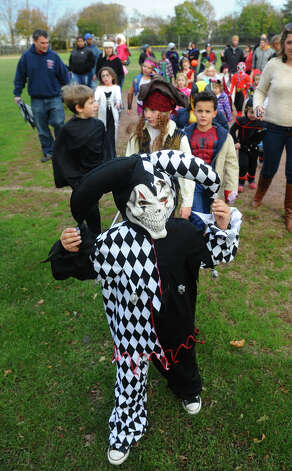 Juliano Barnes, 6, dressed up as an evil jester, during the Fourth Annual Black Rock Halloween Parade and Block Party which was held at Ellsworth Field and ended at the Black Rock Branch Library for snacks in the Black Rock section of Bridgeport, Conn. on Friday November 2, 2012. The event was organized by the library and the Black Rock chapter of the Rotary Club. Photo: Christian Abraham / Connecticut Post