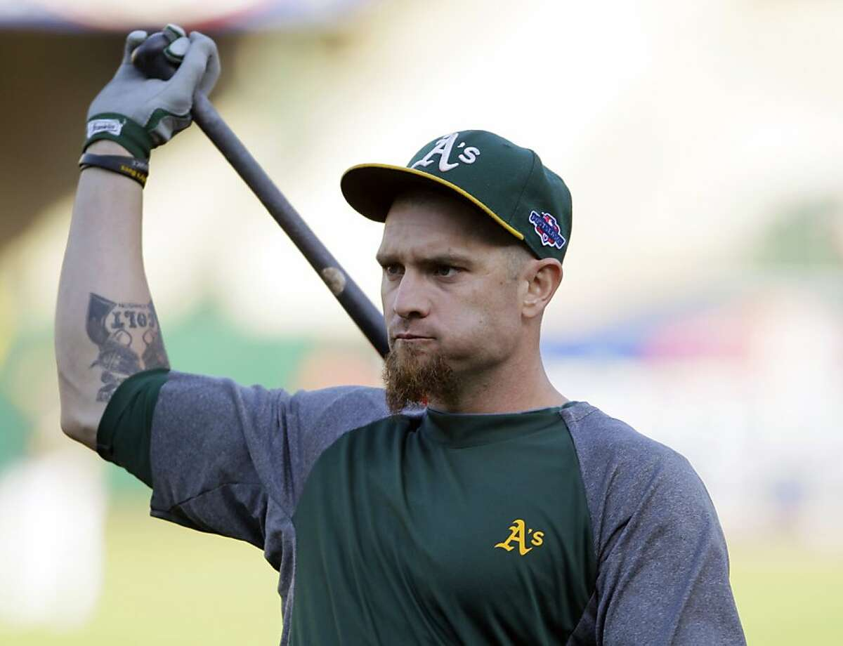 Oakland Athletics left fielder Jonny Gomes warms up before Game 4 of an American League division baseball series against the Detroit Tigers in Oakland, Calif., Wednesday, Oct. 10, 2012. (AP Photo/Eric Risberg)