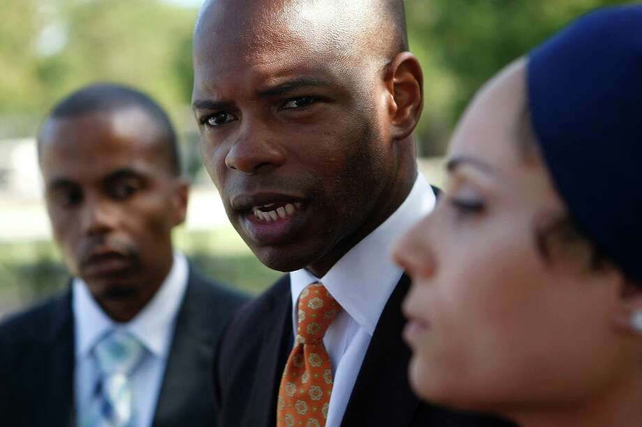 Activists Imam Khalis Rashaad, left, Deric C. Muhammad and lawyer Sadiyah Evangelista-X talk about the recanted rape claim during a news conference on Friday at Cyrill Park. Photo: Johnny Hanson, Houston Chronicle / © 2012  Houston Chronicle