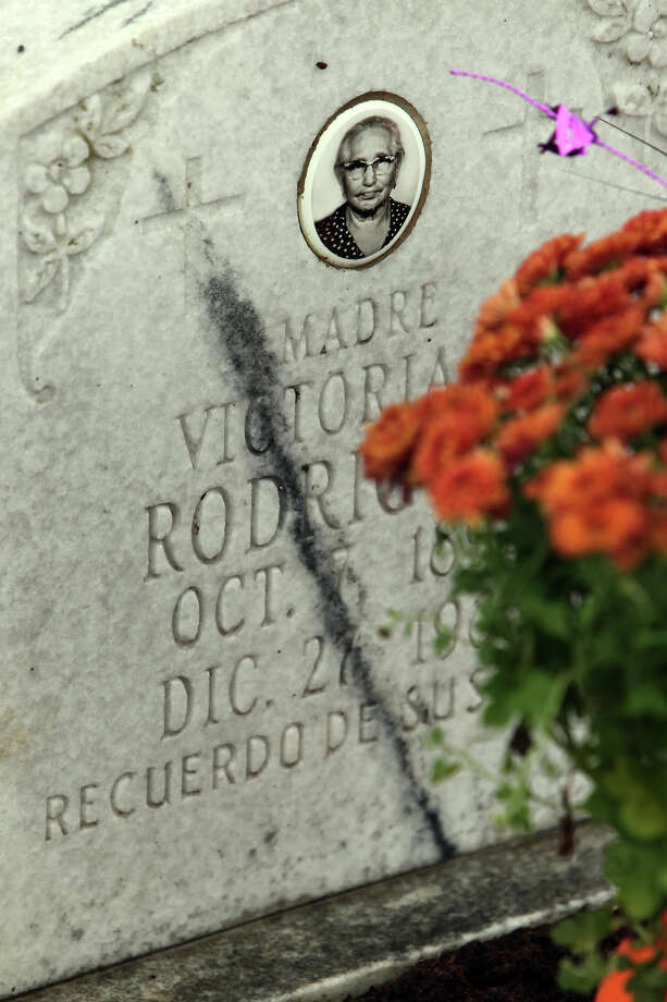A grave is decorated with flowers on the Catholic feast known as All Soul's Day Friday, Nov. 2, 2012. The grave is located at San Fernando Cemetery No. 2. Photo: John Davenport, San Antonio Express-News / San Antonio Express-News