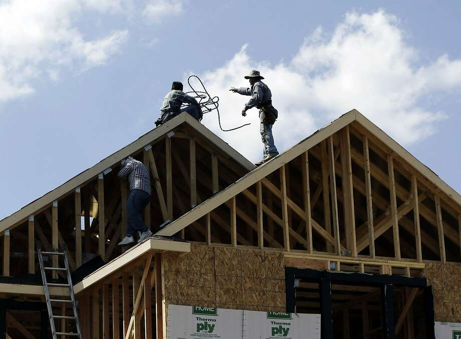 In this Tuesday, Sept. 25, 2012. photo, a house is under construction in San Antonio, Texas. U.S. builders spent more on home construction in September, a gain that helped offset weakness in nonresidential building and government projects. Construction spending grew 0.6 percent compared to August when spending had fallen 0.1 percent, the Commerce Department said Thursday, Nov. 1, 2012. (AP Photo/Eric Gay) Photo: Eric Gay, Associated Press