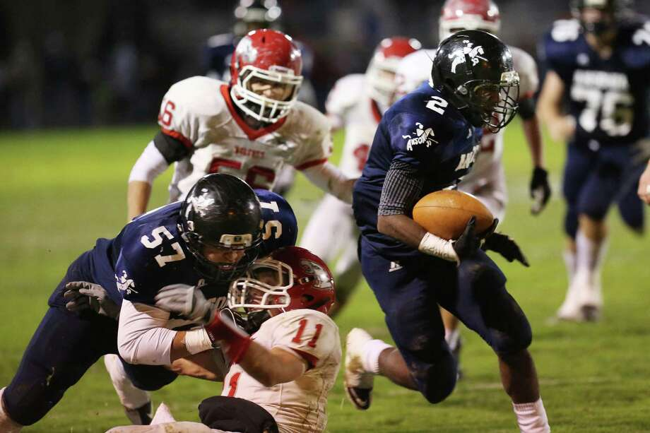Mike Ross Connecticut Post freelance - Ansonia High School's # 2 Arkeel Newsome gains yardage as teammate #57 Antone Mark makes block on Wolcott's Mike Nicol during first half action on Friday evening. Photo: Mike Ross / Connecticut Post Freelance