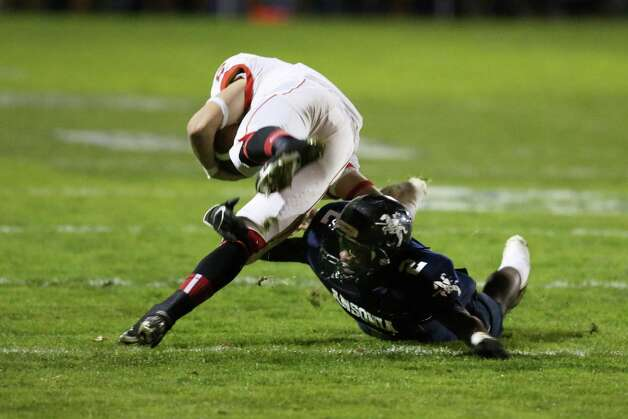 Mike Ross Connecticut Post freelance - Ansonia High School's # 2 Arkeel Newsome makes the tackle on Wolcott's # 2 Joseph Lynch during first half action on Friday evening. Photo: Mike Ross / Connecticut Post Freelance