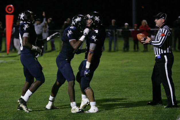 Mike Ross Connecticut Post freelance - Ansonia High School's Captain # 4 Andrew Matos celebrates with teammates after a first half touchdown against Wolcott High School on Friday evening. Photo: Mike Ross / Connecticut Post Freelance