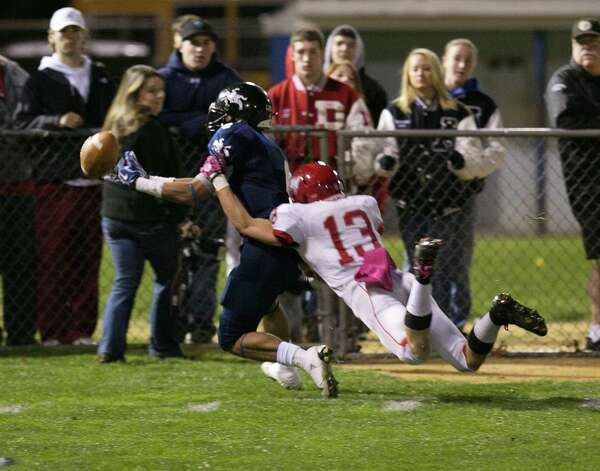 Mike Ross Connecticut Post freelance - Ansonia High School's # 4 Andrew Matos cant handle the pass as Wolcott High School's # 13 Tyler Prescott breaks up the play on Friday evening. Photo: Mike Ross / Connecticut Post Freelance