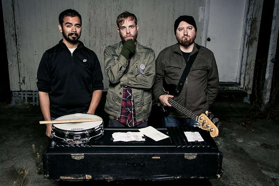 Dogcatcher includes drummer Ramon Esquivel (left), Andrew Heine, who does vocals and plays guitar, and bassist Jared Milos. Photo: Grit Philm