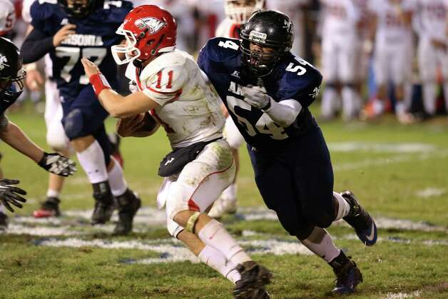 Mike Ross Connecticut Post freelance - Ansonia High School's Captain # 54 Jh'Mel Trammell goes for a sack on Wolcott High School's quarterback # 11 Mike Nicol during first half action on Friday evening. Photo: Mike Ross / Connecticut Post Freelance