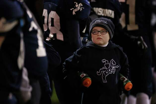 Mike Ross Connecticut Post freelance -  Waterboy Brendan Lynch age 6 of Ansonia during Friday evening match against Wolcott High School. Photo: Mike Ross / Connecticut Post Freelance