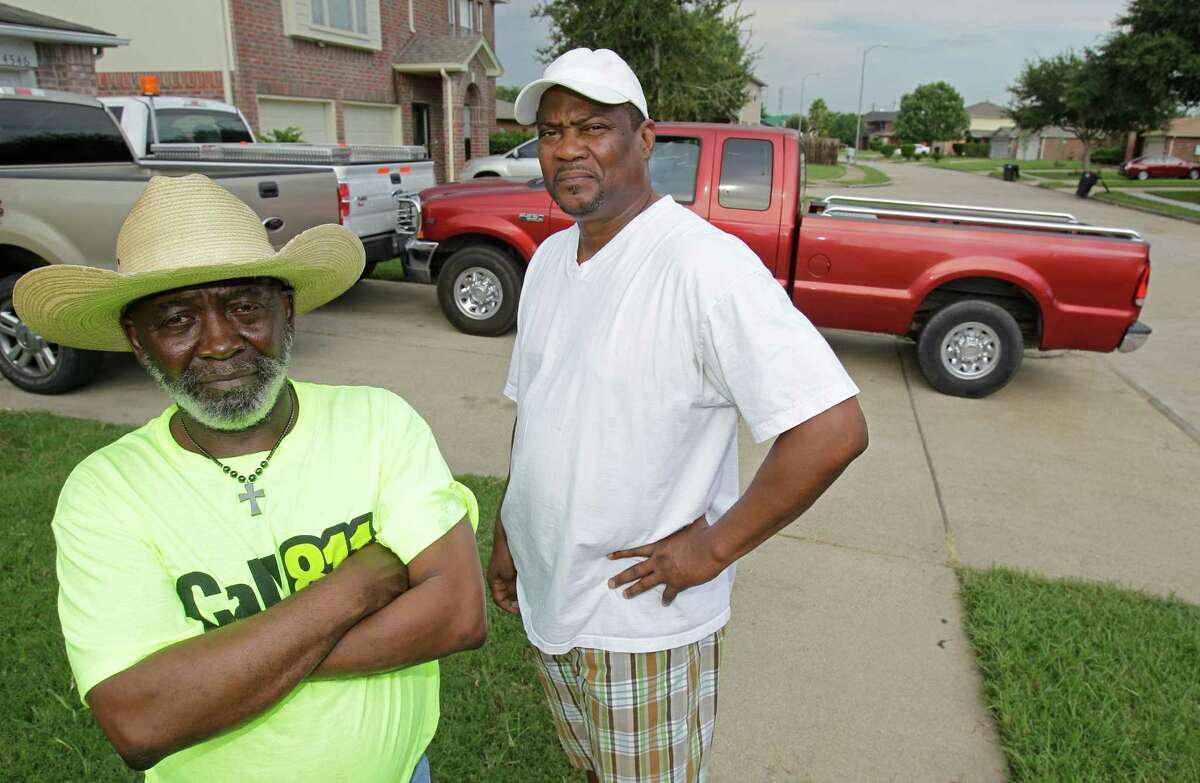 Neighbors Anthony Burrell, left, and Melvin Wilkins recently got tickets for blocking sidewalks.