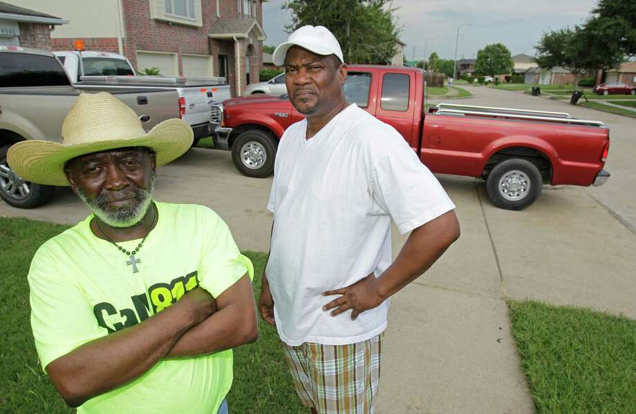 Neighbors Anthony Burrell, left, and Melvin Wilkins recently got tickets for blocking sidewalks. Photo: Melissa Phillip, Staff / © 2012 Houston Chronicle
