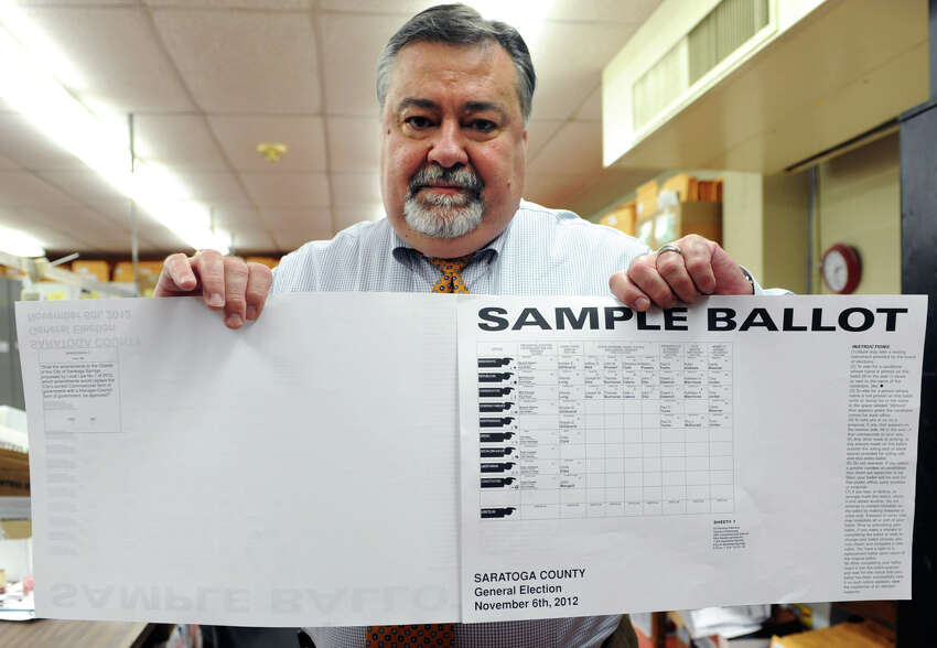 Roger Schiera, Republican commissioner of elections, holds up a double sided sample ballot for Saratoga County at the Saratoga Board of Elections on Friday Nov. 2, 2012 in Ballston Spa, N.Y. (Lori Van Buren / Times Union)