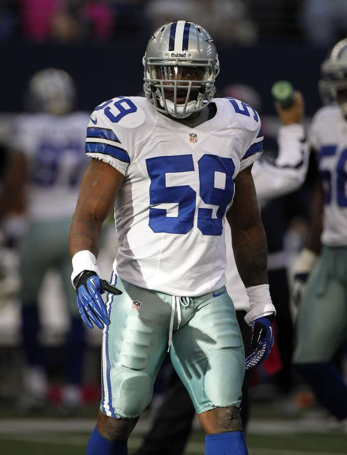 Cowboys linebacker Ernie Sims (59) on the field during the first half against the Giants on Oct. 28, 2012, in Arlington, Texas. Tony Gutierrez/Associated Press