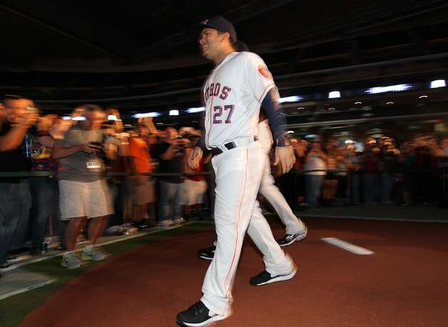 Houston Astros' Jose Altuve walks over the mound in the new Astros uniform at Minute Maid Park, Friday, Nov. 2, 2012, in Houston, as the Houston Astros unveiled their new logo, uniform, and mascot.