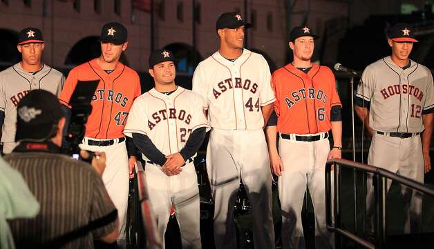 Houston Astros players and minor leaguers model the new uniforms on stage at Minute Maid Park, Friday, Nov. 2, 2012, in Houston, as the Houston Astros unveiled their new logo, uniform, and mascot.