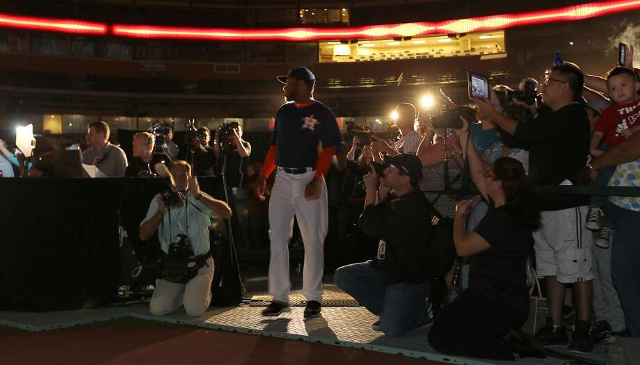 Astros minor leaguer Jonathan Singleton models one of the new Astros uniforms at Minute Maid Park, Friday, Nov. 2, 2012, in Houston, as the Houston Astros unveiled their new logo, uniform, and mascot.