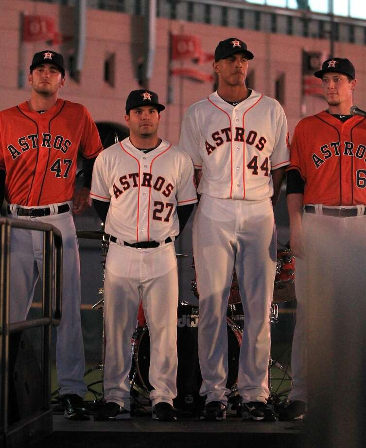 Houston Astros players Jarred Cosart (47), Jose Altuve (27) ,Justin Maxwell (44), and Lucas Harrell (64) model the new uniforms at Minute Maid Park, Friday, Nov. 2, 2012, in Houston, as the Houston Astros unveiled their new logo, uniform, and mascot.