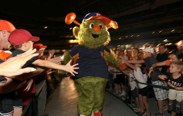 Orbit the Houston Astros' new mascot makes his first appearance in front of fans at Minute Maid Park, Friday, Nov. 2, 2012, in Houston.  Orbit was brought back as the official mascot for the 1990-1999 seasons (was replaced from 2000-2012 by Junction Jack) during a ceremony as the Houston Astros unveiled their new logo, uniform, and mascot.