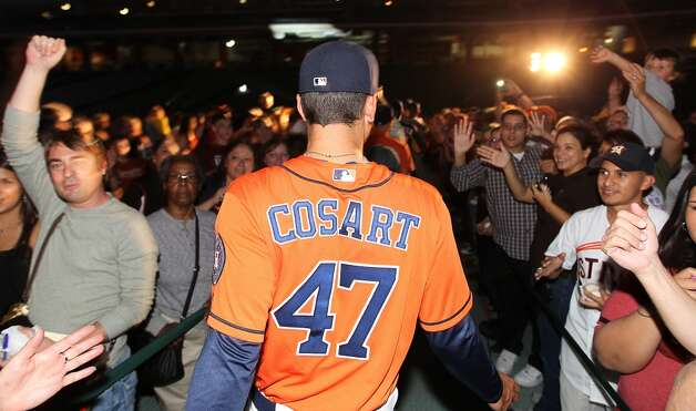 Houston Astros minor league player Jarred Cosart models one of the new Houston Astros uniforms at Minute Maid Park, Friday, Nov. 2, 2012, in Houston, as the Houston Astros unveiled their new logo, uniform, and mascot.