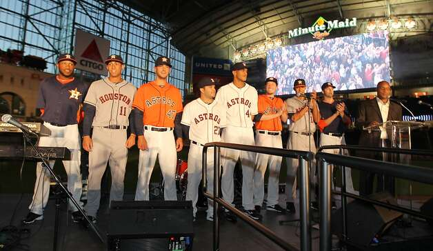 Houston Astros players line up on stage wearing the new uniforms at Minute Maid Park, Friday, Nov. 2, 2012, in Houston, as the Houston Astros unveiled their new logo, uniform, and mascot.