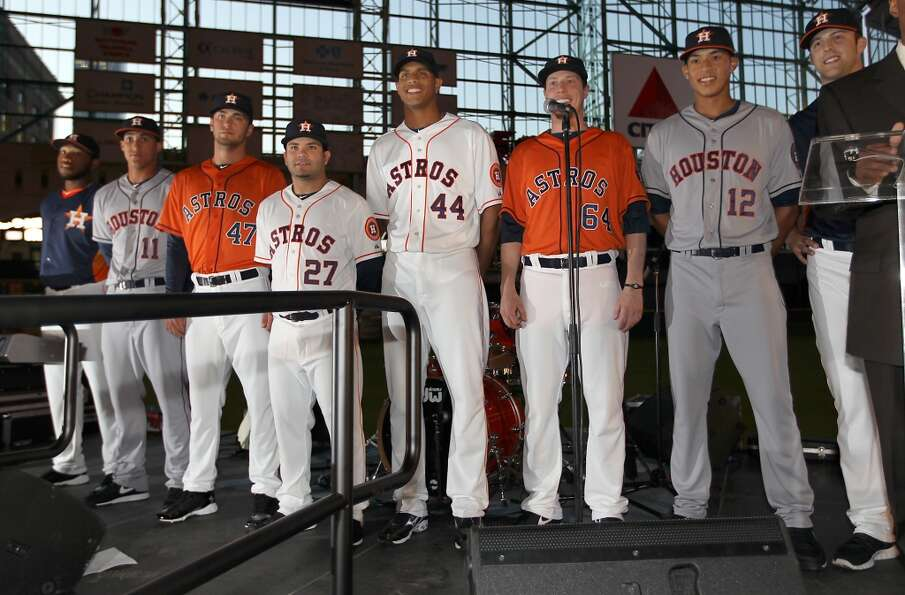 Houston Astros players line up on stage wearing the new uniforms at