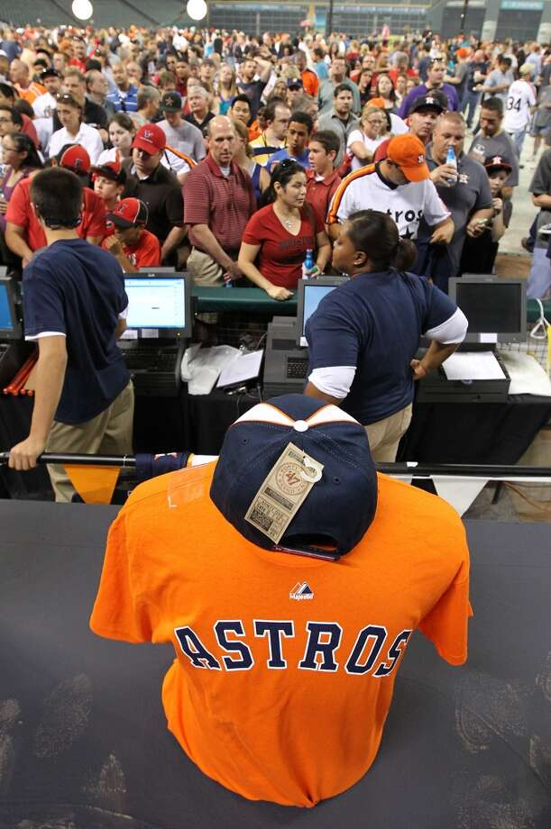 Fans line up to buy merchandise with the new Houston Astros logo at Minute Maid Park, Friday, Nov. 2, 2012, in Houston,after a ceremony where the Astros unveiled their new logo, uniform, and mascot.