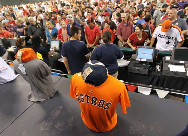 Fans line up to buy merchandise with the new Houston Astros logo at Minute Maid Park, Friday, Nov. 2, 2012, in Houston, after a ceremony where the Astros unveiled their new logo, uniform, and mascot.
