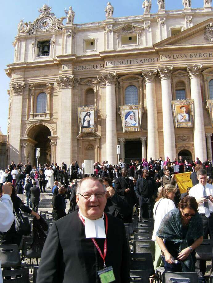 "Troy, NY - La Salle Institute Christian Brother Bernard Knezich recently traveled to Rome to witness the canonization of Kateri Tekakwitha and others on October 21, 2012. Knezich traveled with the Black and Indian Mission Office out of Washington D.C. Established in 1884, the Office works tirelessly supporting Catholic evangelization efforts among Black, Indian and Indigenous communities throughout the United States. The group which traveled from the 18th to 24th of October spent time in Vatican City as well as attending the canonization. Knezich who was raised in Amsterdam, New York has been at La Salle Institute for multiple assignments. He was first in Troy from 1964-1967 and now has been since 1994. He also ministered in Ethiopia and Palestine.  Speaking about his opportunity to experience the event in person, Knezich said ""it was a fantastic experience; so beautiful. I'm very proud to be from the area (that St. Tekakwitha was)."" Pictured below is Br. Bernard at the ceremony in front of St. Peter's Basilica. (Photo provided by Shane Hendry '06)"
