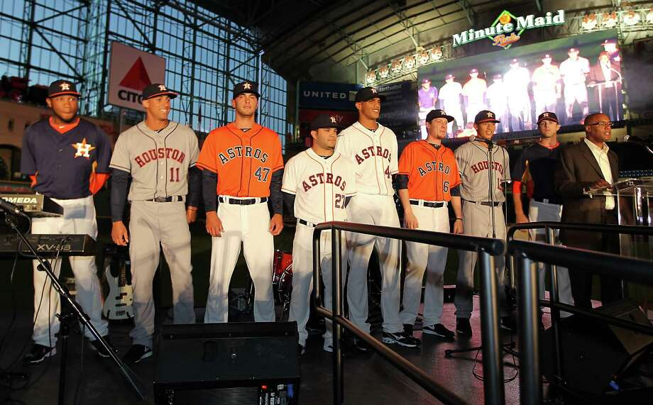 Houston Astros players line up on stage wearing the new uniforms at Minute Maid Park, Friday, Nov. 2, 2012, in Houston, as the Houston Astros unveiled their new logo, uniform, and mascot. Photo: Karen Warren, Houston Chronicle / © 2012  Houston Chronicle