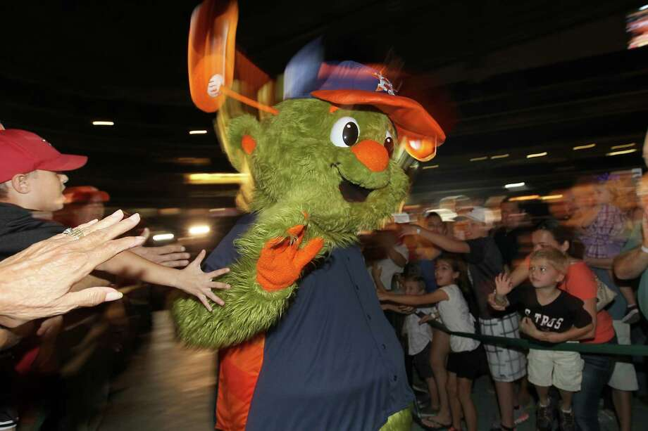 """Orbit"" the Houston Astros' new mascot makes his first appearance in front of fans at Minute Maid Park, Friday, Nov. 2, 2012, in Houston.  Orbit was brought back as the official mascot from the 1990-1999 seasons, after he was replaced from 2000-2012 by Junction Jack,  during a ceremony as the Houston Astros unveiled their new logo, uniform, and mascot. Photo: Karen Warren, Houston Chronicle / © 2012  Houston Chronicle"