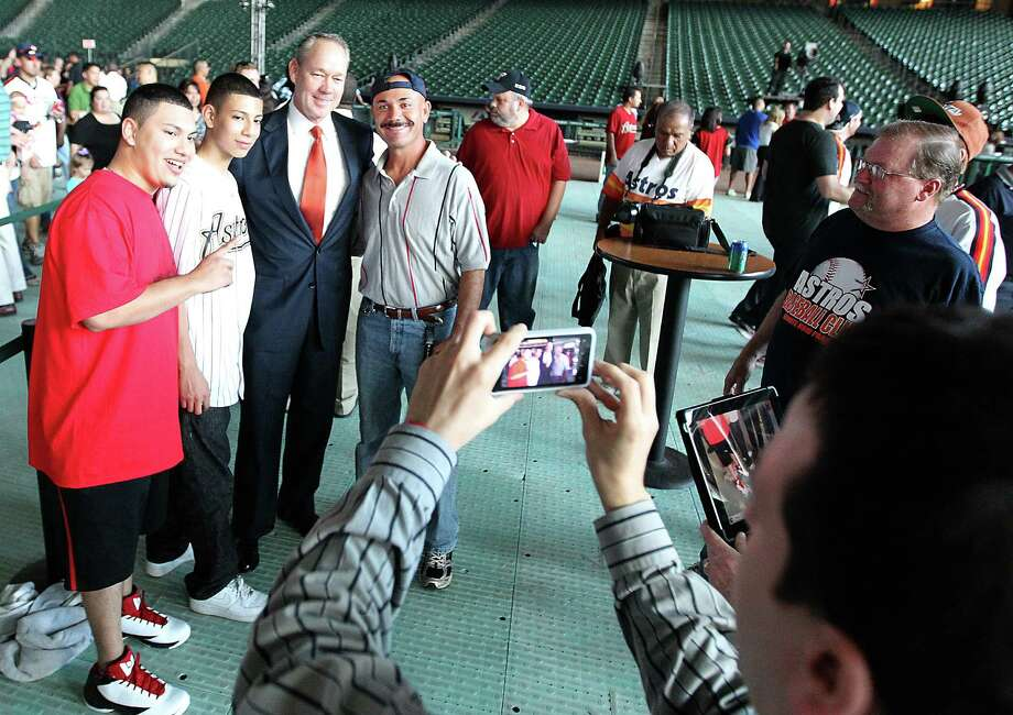 Houston Astros owner Jim Crane poses for a photo with fans at Minute Maid Park, Friday, Nov. 2, 2012, in Houston, before the Houston Astros unveiled their new logo, uniform, and mascot. Photo: Karen Warren, Houston Chronicle / © 2012  Houston Chronicle