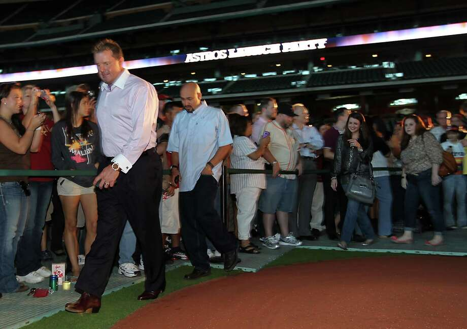Former Houston Astros pitcher Roger Clemens makes his way into the VIP area at Minute Maid Park, Friday, Nov. 2, 2012, in Houston, before the Houston Astros unveiled their new logo, uniform, and mascot. Photo: Karen Warren, Houston Chronicle / © 2012  Houston Chronicle