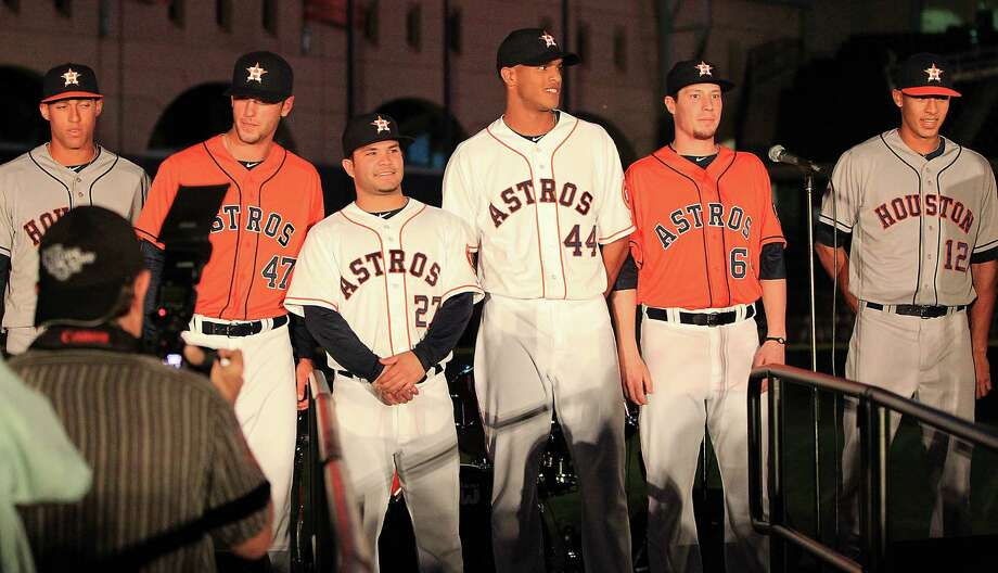 Houston Astros players and minor leaguers model the new uniforms on stage at Minute Maid Park, Friday, Nov. 2, 2012, in Houston, as the Houston Astros unveiled their new logo, uniform, and mascot. Photo: Karen Warren, Houston Chronicle / © 2012  Houston Chronicle