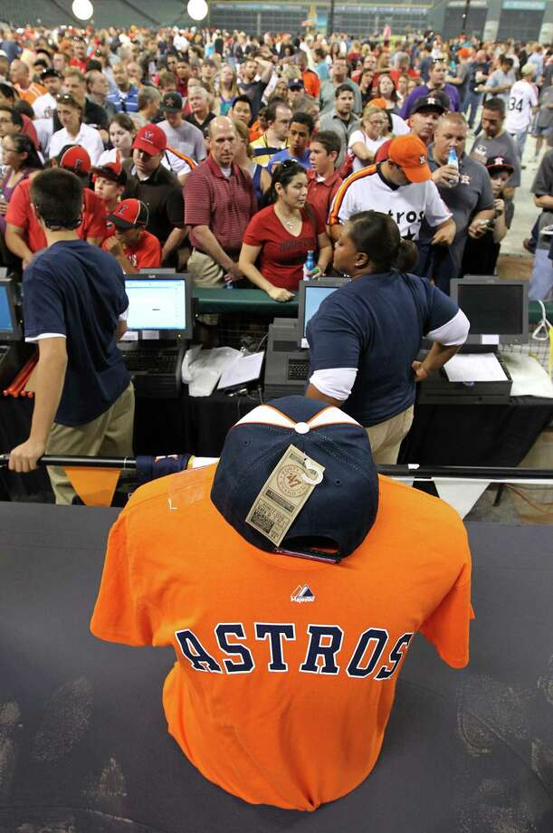 Fans line up to buy merchandise with the new Houston Astros logo at Minute Maid Park, Friday, Nov. 2, 2012, in Houston,after a ceremony where the Astros unveiled their new logo, uniform, and mascot. Photo: Karen Warren, Houston Chronicle / © 2012  Houston Chronicle