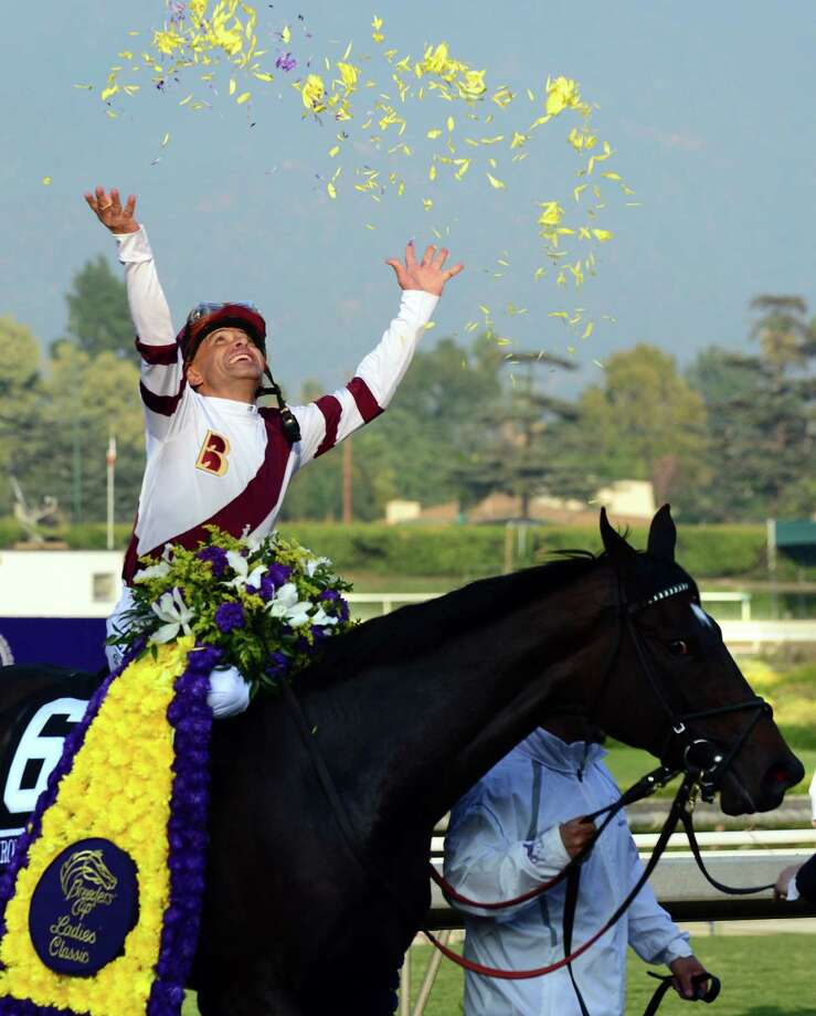 Jockey Mike Smith celebrates after riding Royal Delta to victory in the Breeder's Cup Ladies' Classic  at Santa Anita Park on Friday. Photo: FREDERIC J. BROWN, Staff / AFP