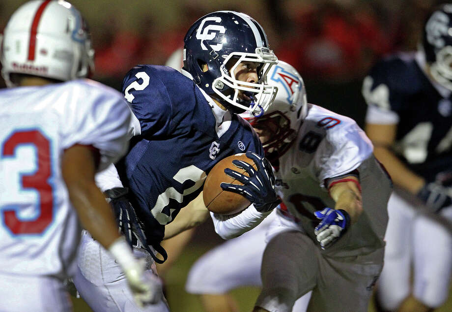 Lashawn Thomas takes a return up the middle for the Buttons as Central Catholic hosts Antonian at Benson Stadium on November 2, 2012. Photo: Tom Reel, Express-News / ©2012 San Antono Express-News