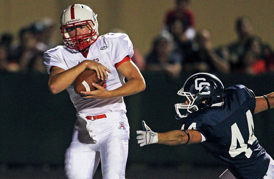 Jarrett Pawelek pulls in a touchdown pass behind Nick Gonzaba as Central Catholic hosts Antonian at Benson Stadium on November 2, 2012. Photo: Tom Reel, Express-News / ©2012 San Antono Express-News