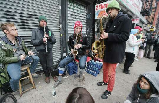 Members of the Rude Mechanical Orchestra perform an impromptu jam session on the Avenue C shortly after power was restored in Manhattan's East Village on November 2, 2012 in New York City. Millions of customers in New Jersey and New York remain without power following Superstorm Sandy as colder weather approaches. Photo: Mario Tama, Getty Images / 2012 Getty Images