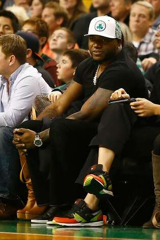 David Ortiz, taking in the Celtics' home opener, apparently will be sticking around Boston for at least two more years. Photo: Jared Wickerham, Getty Images