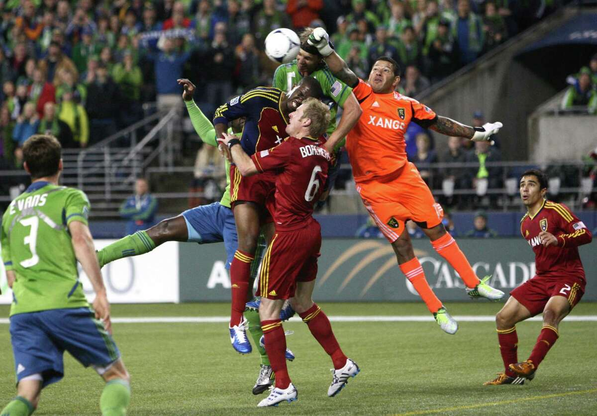 Real Salt Lake goalie Nick Rimando swats a ball kicked by Mauro Rosales away from the goal during an MLS Western Conference semifinal on Friday, November 2, 2012 at CenturyLink Field in Seattle.