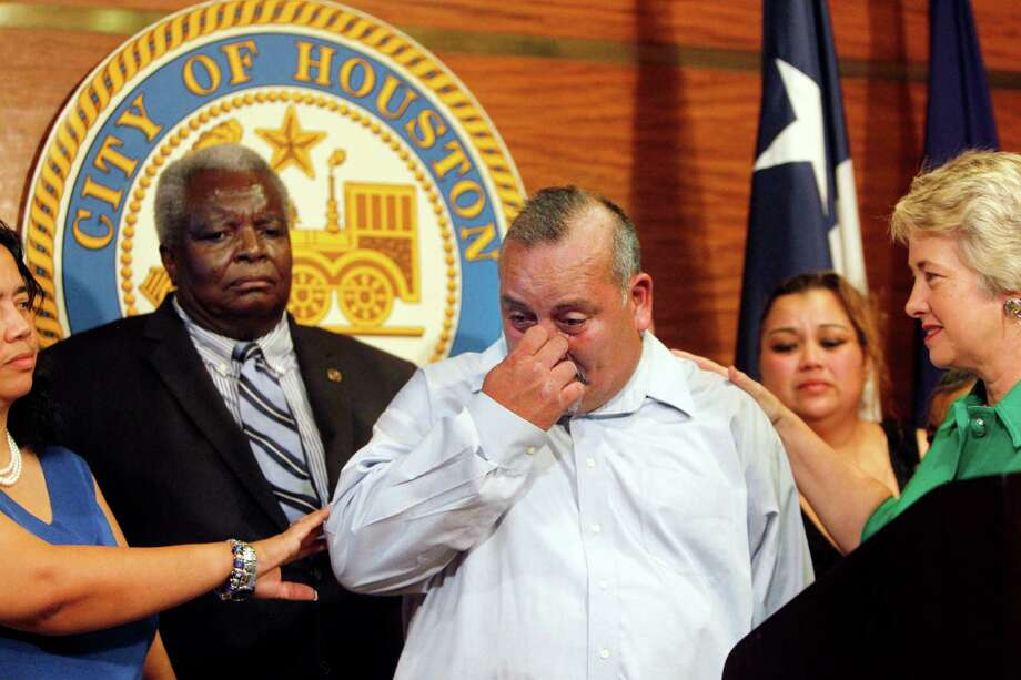 George Rodriguez wipes tears after addressing the media during a news conference with Mayor Annise Parker on Friday. Photo: Mayra Beltran, Staff / © 2012 Houston Chronicle