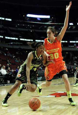 File-This March 28, 2012 file photo shows McDonald's West All-American Morgan Tuck (44) driving the ball past her future UConn teammate Breanna Stewart (30) during the first half of the McDonald's All-American Women's basketball game in Chicago. Now UConn freshmen Stewart, Tucker, and Moriah Jefferson  have become good friends. In fact, Stewart and Jefferson like to hit Tuck with pillows, and all three have a laugh. On court, the three are expected to pummel opponents for the next four years.  (AP Photo/Charles Rex Arbogast, File) Photo: Charles Rex Arbogast, Associated Press / AP